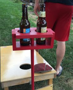 Never spill your drink when playing yard games again! This drink holder holds your drink at arm level while you play your favorite outdoor game. -36 removable wooden dowel rod easily sides into the wooden drink stand  -2 Large cup holders can fit any beverage- Each are 3 in diameter -Sturdy & Easy to store  -Painted in your favorite color -Sealed for protection from the elements -Great gift idea! -Many colors available