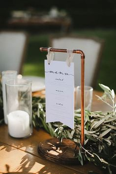 What an inventive way to display the menus - use old pipes to create a stand - such a great idea for a rustic, industrial wedding. #WeddingDecor #Weddingdetails #WeddingInspiration #RusticWedding #IndustrialWedding