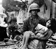 FEB  10 1945 Japanese infiltrate US lines during Manila battle - See more at: http://ww2today.com/ An American soldier in Manila  rescuing an injured Filipino girl (February 1945).