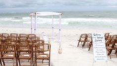 Ice blue sashes and bamboo chairs with our 'unplugged' wedding sign