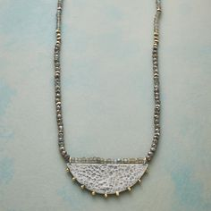 """HALF MOON NECKLACE--A hand-cast half moon of sterling silver, lightly pebbled and tipped with brass beads, holds court among iridescent mystic labradorite, shimmering labradorite and Thai silver beads. Sterling lobster clasp. Exclusive. 17"""" to 20""""L."""