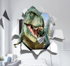 Run for your life! A terrifying T-Rex wall sticker that is ideal for decorating kids bedrooms.  Create a fun illusion on your walls with this great design of a Tyrannosaurus Rex that looks as though he is bursting into your room! Perfect for adding a bold centre piece to a dinosaur themed bedroom. No dinosaur fans room would be complete without the king of the dinosaurs himself; the might T-Rex. #Dinosaur #WallSticker #3D