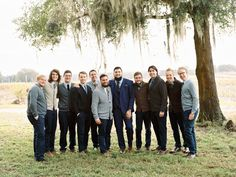 #Groomsmen in sweaters | Photography by ryanrayphoto.com  Read more - http://www.stylemepretty.com/2013/08/26/florida-wedding-from-ryan-ray-photography/