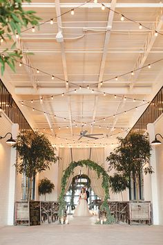 Rustic indoor wedding ceremony | Wedding & Party Ideas | 100 Layer Cake