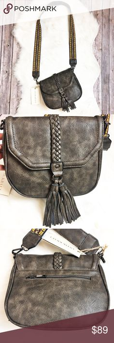 """Antik Kraft Beautiful dark gray purse with a braid down the from and tassels.  Crossbody strap is Embroidered.  Shell is polyurethane and lining is polyester.  Features a zipper and magnetic closure with a zippered pocket on the inside and on the back too.  Measurements: 11"""" x 8.25"""" x 3.6 """". Measurements are approximate.  🚫No Lowballers🚫No Scammers🚫No Trades🚫 Antik Kraft Bags Crossbody Bags"""