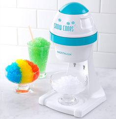 Nostalgia Electrics White Electric Snow Cone Maker produces snow-like shaved ice, perfect for snow cones, slush drinks, margaritas and daiquiris. Small Kitchen Appliances, Home Appliances, Kitchen Small, Discount Appliances, Snow Cone Machine, Dessert Makers, Snow Cones, Ice Cream Desserts, Specialty Appliances