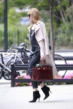 Olivia Palermo in black leather overalls