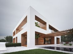 Architect Michal Nowak cleverly brings the outside in with cut-out walls enclosing a majestic tree at the Holes House. Modern Residential Architecture, Amazing Architecture, Interior Architecture, Pavilion Architecture, Sustainable Architecture, Design Exterior, Modern Exterior, House Seasons, Modern Mansion
