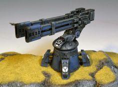 Tau Empire Area Denial Turret. Wargear: twin-linked heavy-railgun; networked-markerlight; velocity-tracker.