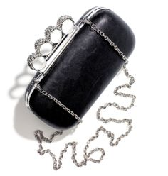 Avon: mark Case of Glam Clutch. The edgiest clutch of all, the knuckle-duster minaudière, shows you've got a grip on serious rock 'n' roll style. Hinged silvertone shoulder chain offers another way to wear. Faux leather hard-bodied frame featuring built-in silvertone knuckle rings covered with glass rhinestones.