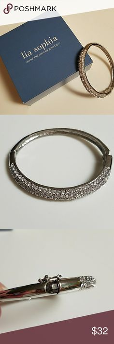 Liz Sophia Glitterati bangle bracelet This is the dazzling Glitterati bracelet. Retired Lia Sophia hinged bangle bracelet with cut crystals. Worn only a few times, EUC. Comes with original box and foam protection. Lia Sophia Jewelry Bracelets