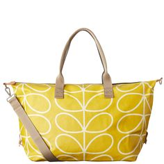 Orla Kiely Weekend Bag - Dandelion Print: Matt laminated weekend bag in the classic Linear Stem print with leather trims and double sided webbing handles. Contrast coloured zip closure. Inside details include orange 'Linear Stem' jacquard lining, small zip pocket, small leather logo card holder pocket, elasticated key chain and mobile pocket. Silver coloured hardware.