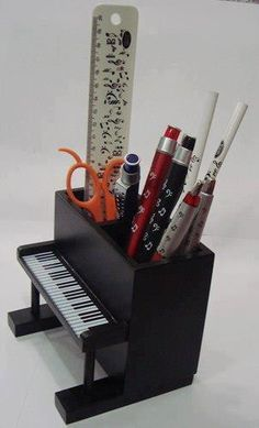 Piano keyboard desk organiser