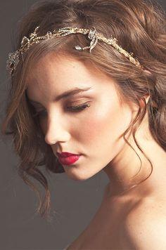 A gold crystal wedding headband is a beautiful wedding hair accessory for an elegant outdoor wedding.
