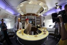 Emirates first class cabin offers a bar and lounge area for passengers. Emirates A380, Emirates Flights, Emirates Airline, First Class Airline, Flying First Class, Airplane Interior, Airplane Travel, Next Holiday, Cabin Crew