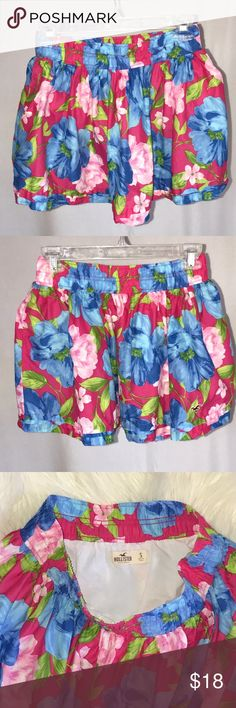 """Hollister Aqua Pink Floral Full Cotton Mini Skirt Adorable and fun bright bold Floral pattern a full skirt.  Shades of hot pink, Aqua and green.  Elastic waist.  Pleated hemline.  Fully lined. 100% cotton. Machine wash cold.  Only worn couple times. In excellent like new condition.  Size Small:  waist across laying flat 12"""", length 13.75"""". Hollister Skirts Mini"""