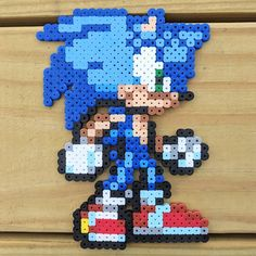 """Pixel Sonic"" (2017) - Sonic the Hedgehog in perler beads . . . #art #artist #artshare #artofinstagram #artistsoninstagram #instaart #instaartist #artlife  #creative #gallery #craft #crafts #handmade #gaming #videogames #gamergirl #sonic #sega #familyfun #family #pixelart #perlerbeads #perler #hedgehog #90s #retro #gamer #nofilter #j9creationstudio"