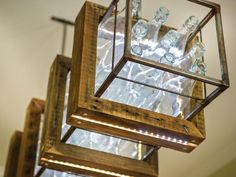 The showpiece is an upcycled light fixture made from 36 vintage glass bottles.