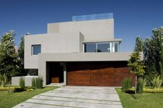 Modern Garage Doors Design | Incredible Modern Waterfall House by Andres Remy Architects, Argentina