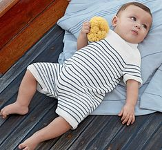 Worked in blue and white stripes, this lightweight baby romper suit encapsulates the style of the classic Breton jumper. The short legs are worked first, then joined at the gusset to work the body and raglan shaping.It's finished with little sleeves and stretchy garter stitch edgings, and snap fastenings on the back and between the legs. The pattern calls for Bergère deFrance's Coton Fifty yarn, which is a soft, machine-washable cotton blend that comes in a choice of 20 colours.