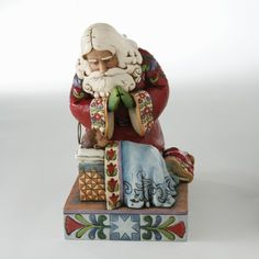 Jim Shore Figurines - Jim Shore - Santa with Baby Jesus/--have this, I just love the praying santas and have for several years. This is one of my favorite Christmas decorations.