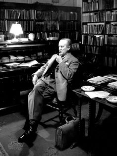 JRR Tolkien. Like a boss. I ADORE this office!  I must have one.