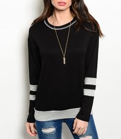 This fashionable sweater is great quality and made in the U.S  Comes in sizes SML  (fits true to size)