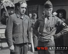This Nazi prisoner was a Brooklyn butcher for 10 years before returning to Germany to fight for the Master Butcher -- Hitler.  Captured in Normandy, he is pictured here aboard a Coast Guard-manned transport which is carrying him back to the United States -- this time for internment.  An Army Military Police Officer stands nearby.