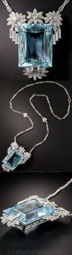 Vintage Aquamarine, Platinum and Diamond, Breathtaking! A beautiful sky blue aquamarine, weighing 32 carats, fancifully faceted around the crown (i.e. the border), is elegantly embellished on top with sparkling platinum and diamond flowers dripping with slender diamond baguettes, and below with a complimentary design composed of the same. A singular and stunning necklace dating from the 1930s-40s. The original fancy link platinum chain.