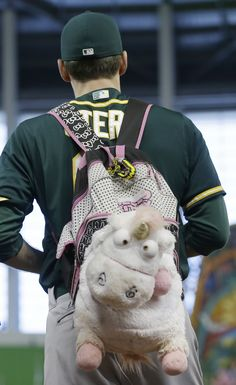 Oakland Athletics pitcher Dan Otero with his pink unicorn backpack before a game against the Miami Marlins.
