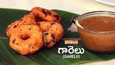 Andhra Style Garelu (Vada)  Ingredients    Urad Dal - 200 gms  Raw Rice - 1 tbsp  Water - 2 cups  Salt to taste   Onion - 1 chopped  Chopped Ginger - 1 tsp  Green chilli - 1 chopped  Cumin seeds - 1 tsp  A few chopped Coriander leaves  A few Curry leaves  Oil for Frying    Method:  1. Take 200gms of Urad Dal with 1tbsp Raw Rice.  2. Soak it for about 90 minutes in water.  3. Once it soaked grind it in a mixer with out adding water while grinding add salt. The Batter should be thick almost…