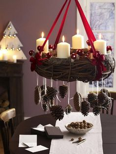 Yule candle wreath with mushrooms and dangling pine cones....