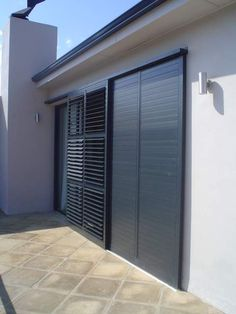 The Aluvent adjustable blade shutters comprises of low maintenance aluminium louvre blades enclosed within an aluminium frame. Window Shutters Exterior, Outdoor Shutters, Roller Shutters, Wooden Shutters, Door Design, Exterior Design, House Design, American Shutters, Security Shutters