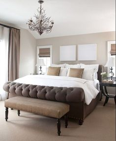 Master bedroom idea. I like the stool at the end of the bed.