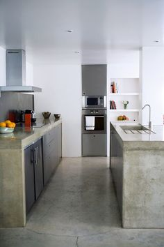 floors and built in's  white walls. Source unknown  Concrete countertop & island. Too much?