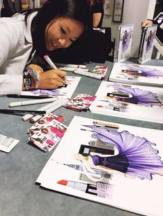 fashion illustrator Rongrong DeVoe at Maybelline New York BeautyCon Booth live sketch customers.