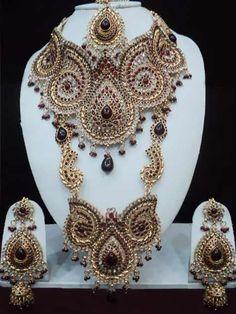 #Maroon and Off White #Polki Studded #Necklace Set @ $249.99   Shop @ http://www.utsavfashion.com/store/item.aspx?icode=jjr5456
