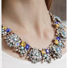 Dazzling glam statement necklace Bold in design, refined in details. This glam statement necklace features a beautiful flower inspired design in hues of royal blue, gold, and white rhinestones. Perfect choice for a date night. Jewelry Necklaces