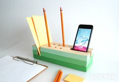 How great is this DIY desk organizer? A few pieces of wood and an afternoon are all you need to craft your own version!