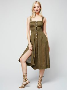 Girlfriend Material Dress | Easy breezy lightweight midi dress featuring delicate buttons down the front. Smocked elastic band in back with a back cutout. Removable straps, raw trim and hip pockets complete the look. *An Endless Summer- Whether you live the beach lifestyle year-round or dream of making the great escape, explore the collection of our most effortlessly ethereal styles under the sun.