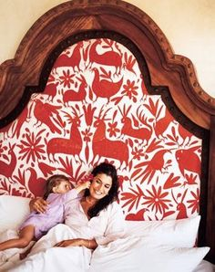 this headboard is amazing! not necessarily this fabric, but still awesome.