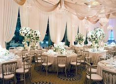 Ivory Ballroom with Elegant Drapery | Photo: Jose Villa Photography. View More: http://www.insideweddings.com/weddings/glamorous-sophisticated-garden-themed-ballroom-wedding-in-chicago/905/