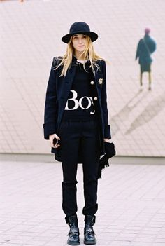Lolita Jacobs in a graphic sweatshirt, blazer, wide brimmed hat and boots