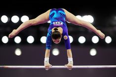 Aliya Mustafina Photos Photos - Aliya Mustafina of Russia competes on the Uneven Bars in the Women's Individual All-Around final on day six of the Baku 2015 European Games at National Gymnastics Arena on June 18, 2015 in Baku, Azerbaijan. - Artistic Gymnastics - Day 6: Baku 2015 - 1st European Games