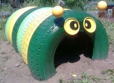 caterpillar made with recycled tires painted bright colors