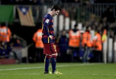 Barcelona's Argentinian forward Lionel Messi looks downwards after a goal by Sevilla during the Spanish league football match FC Barcelona vs Sevilla FC at the Camp Nou stadium in Barcelona on February 28, 2016.