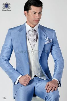 Sky blue shantung suit with notched lapel and two buttons closure. Flap pockets, ticket pocket and angled buttonholes. Twin vents at back, style 785 Ottavio Nuccio Gala, 2015 Fashion Collection. Prom Suits For Men, Dress Suits For Men, Mens Suits, Men Dress, Groom Suits, Slim Fit Tuxedo, Tuxedo For Men, Smoking, Blue Suit Men