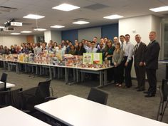 Protiviti NYC City Harvest Event.  Packing boxes of food for the holidays for those in need.