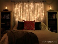 Fairy light and voile curtain headboard!