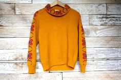 I'd wear it with those vintage Wrangler striped shorts in her shop that I just pinned. *drool* Zero made in SPAIN vintage yellow knit sweater by MFjewels on Etsy, $28.00